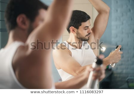 Man spraying deodorant stock photo © lovleah