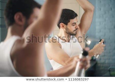 Man spraying deodorant stock photo © lovleah