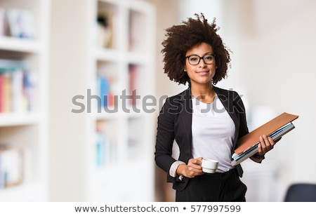 portrait of a young business woman with papers in the office stock photo © dacasdo