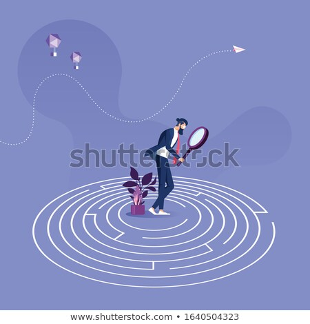 A person stuck in a maze trying to think of a way out  Stock photo © dacasdo