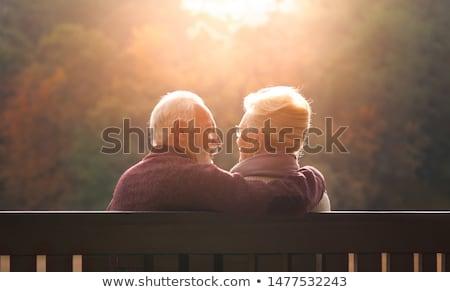 Portret para ławce człowiek tle lata Zdjęcia stock © photography33