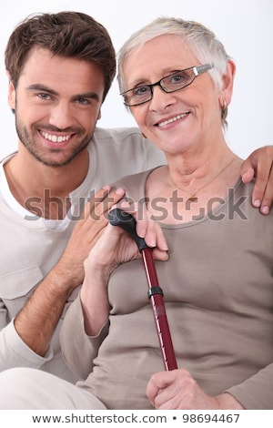 smiling young man with his arms around a senior woman in glasses stock photo © photography33