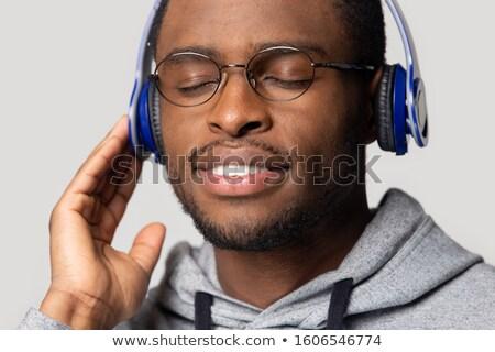 vent · genieten · muziek · geek · persoon · hoofdtelefoon - stockfoto © stockyimages