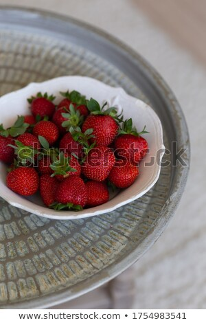Fresh strawberries are in round metal bowl Stock photo © vetdoctor