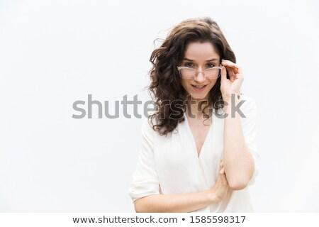 Mirando gafas blanco mujer cara Foto stock © pzaxe