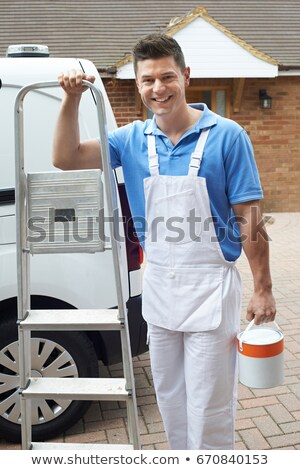 Manual worker with a stepladder Stock photo © photography33