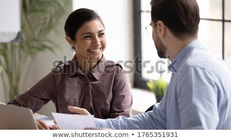 gelukkig · zakenvrouw · hoofdtelefoon · armen · gevouwen · permanente - stockfoto © stockyimages