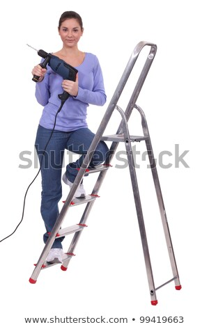 Woman stood on ladder holding power drill Stock photo © photography33