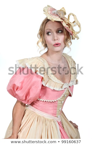 Woman in a theatrical pink and cream dress and bonnet stock photo © photography33