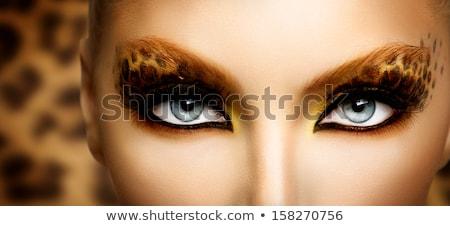 the leopard makeup fashion girl stock photo © carlodapino
