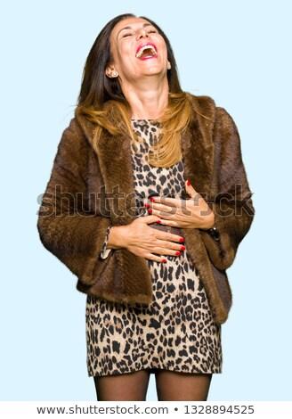 joyful woman wearing leopard coat stock photo © acidgrey
