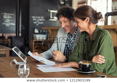 Mature couple with a report Stock photo © photography33