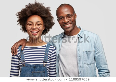 Delighted woman hugging her boyfriend smiling at camera Stock photo © wavebreak_media