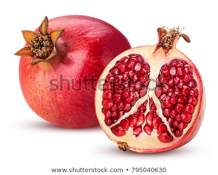 pomegranates on a white background Stock photo © shutswis