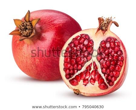 pomegranates on a white background stock photo © shutswis