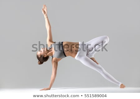 Young female in sports wear against a white background Stock photo © wavebreak_media
