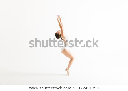 Ballerina standing on her tiptoes against a white background Stock photo © wavebreak_media