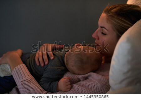 Peaceful baby lying on the chest of her mother indoors stock photo © wavebreak_media