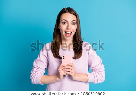 Attractive young woman looking at you Stock photo © pablocalvog