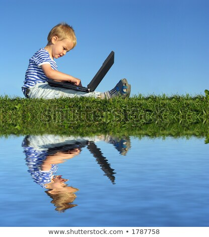 child with notebook sit blue sky and water Stock photo © Paha_L