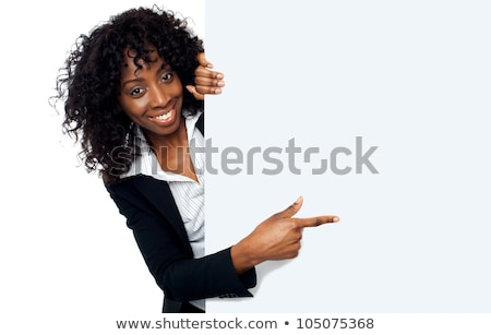 Business lady pointing towards ad on billboard Stock photo © stockyimages