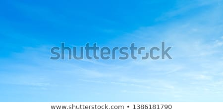 Blue beautiful sky with white clouds view in sunny day, nature stock photo © lunamarina