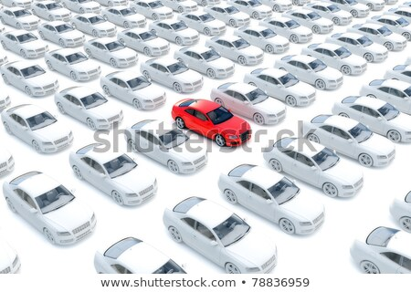 one red car in lot of white vehicles stock photo © iqoncept
