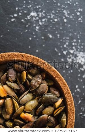 Sağlıklı tost kabak tohumları ahşap çanak Stok fotoğraf © klsbear