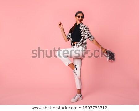 Blonde woman with animal print bag stock photo © user_6981622