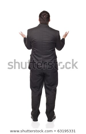 Rear view upset Caucasian businessman raising arms in disbelief Stock photo © dgilder