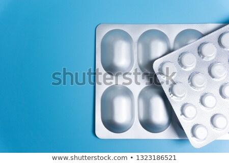 Leczyć grypa opakowanie pigułki zielone otwarte Zdjęcia stock © tashatuvango