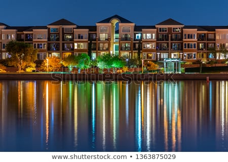 Condo Buildings Reflected in Lake with Trees Stock photo © jameswheeler