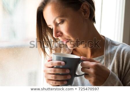lonesome woman drinking coffee in dark room stock photo © stevanovicigor