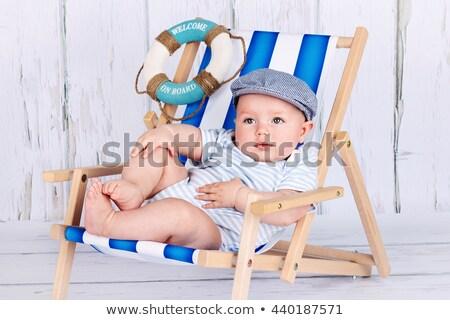 Baby boy in deckchair Stock photo © nyul