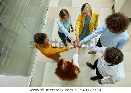 Photo from above of business people showing unity Stock photo © deandrobot