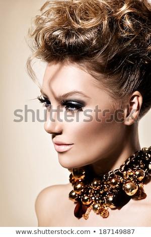 Styling. Profile of Glamorous Woman with Golden Hairdo Stock photo © gromovataya