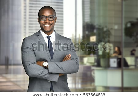 Bonito empresário brasão dobrado retrato isolado Foto stock © deandrobot