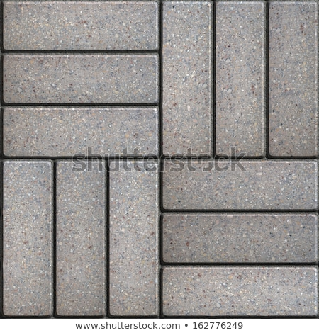 Gray Paving Slabs of Rectangles Laid Out on Three Pieces Perpendicular to Each Other. Stock photo © tashatuvango