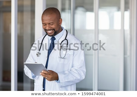 sorrindo · médico · sorridente · mulher · atraente - foto stock © wavebreak_media