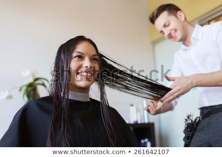 hairdresser smiling and styling customers hair stock photo © wavebreak_media