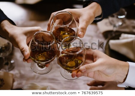 Potable brandy hermosa niña vidrio Servicio fiesta Foto stock © ssuaphoto