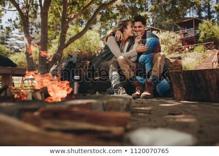 Casal fogueira floresta feliz belo mulher Foto stock © deandrobot