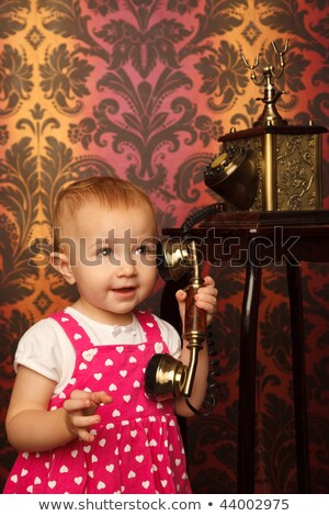 Little girl in red dress talking vintage phone. Interior in retro style. Vertical format. Stock photo © Paha_L