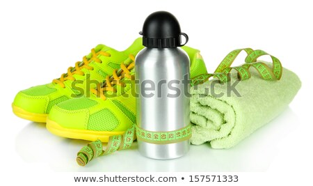 Fitness concept, running shoes and centimeter Stock photo © blasbike