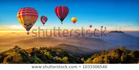Balão de ar quente pôr do sol ilustração natureza montanha silhueta Foto stock © adrenalina