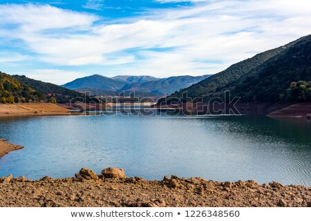 ladonas artificial lake in greece against a blue sky with clouds and mountains as background stock photo © ankarb