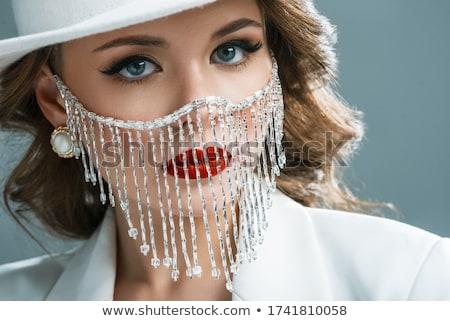 Beautiful stylish glamour woman with masking hat Stock photo © zurijeta