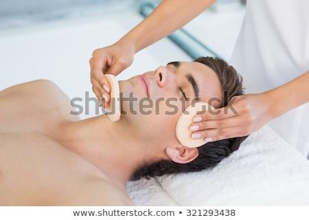 Stock photo: Attractive woman receiving facial massage