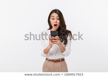 Rozczarowany mylić asian kobieta interesu smartphone odizolowany Zdjęcia stock © deandrobot