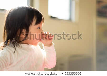 Stock photo: child sucking finger